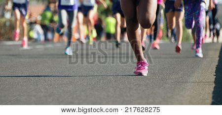 Running children, young athletes run in a kids run race