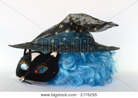 Mask, Magical Hat And Wig On A White Background