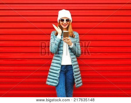 Fashion Laughs Woman Takes A Picture Self Portrait On A Smartphone On Red Background