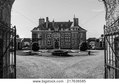 The entrance to the Manor house of Lebioles, Manoir de Lebioles at Creppe, Spa, Belgium, black and white photography