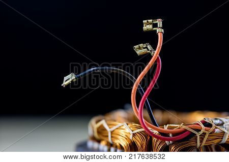 Parts For An Electric Motor On A Wooden Table. Stator Of The Engine On A Wooden Workshop Table.