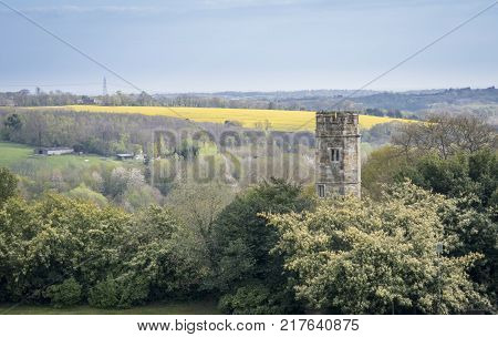 View of the Sussex countryside at Battle with 11th century tower remains of Battle Abbey chapter house Sussex UK