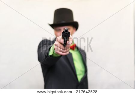 The spy. Secret service. Detecive agent holds pistol gun in his hands and aiming. Retro gangster isolated on white background.