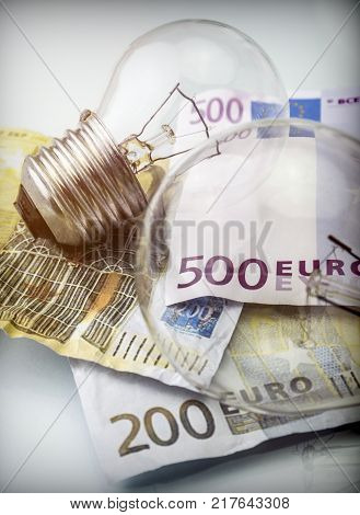 A lightbulb on euro bill, energy saving concept