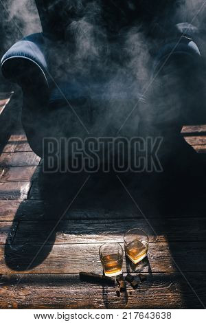 alcohol drinks and cigar on wooden background. Wealthy men indulgent luxury lifestyle concept
