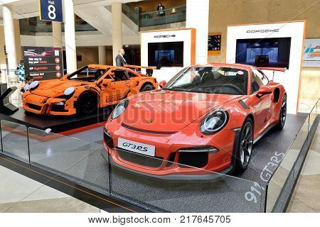 DUBAI UAE - NOVEMBER 18: The Lego-made Porsche GT 3RS and Porsche 911 GT 3RS sportscar is on Dubai Motor Show 2017 on November 18 2017