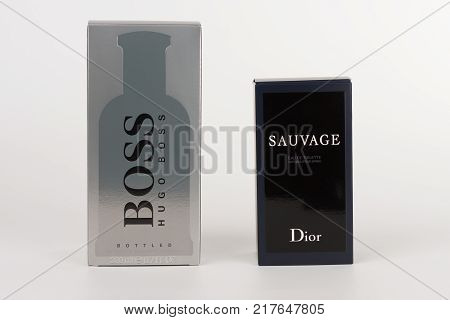 Brnenec ,Czech Republic-December 5,2017: Boxes of EDT for men Hugo Boss Boss Botled and Dior Savuage on white background.