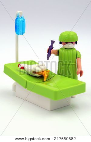 Amsterdam, The Netherlands-  December 10, 2017: Playmobil veterinarian inoculates a chicken against bird flu.