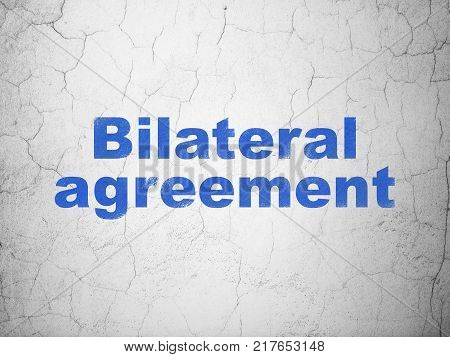Insurance concept: Blue Bilateral Agreement on textured concrete wall background
