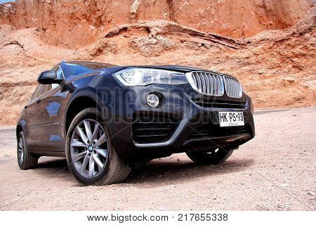 Antofagasta Chile - November 15 2015: Modern black crossover BMW X4 xDrive 2.8i (F26) in the Valle de la Muerte (Mars Valley) in the Atacama Desert.