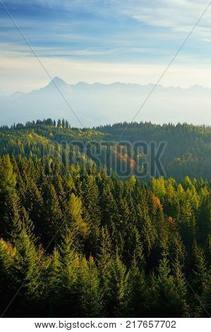 High Tatras scenery from hydroelectric power plant Cierny Vah. Sunrise in Slovakia. Monumental peaks in autumn.