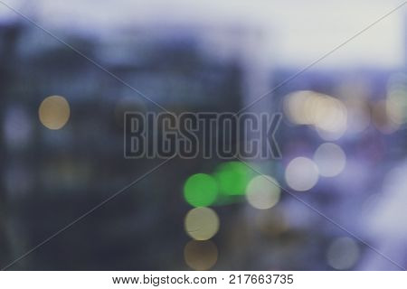unfocused city lights creating colorful bokeh and residential buildings