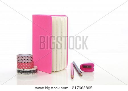 pink stationery on white background table studio