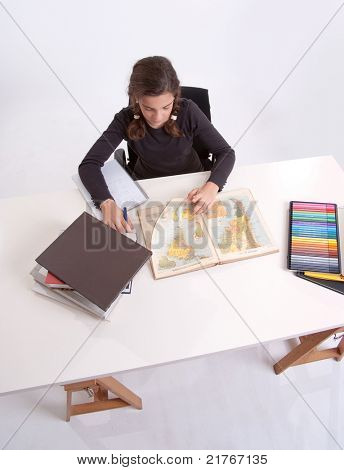 Aerial view of a young schoolgirl working at her desk