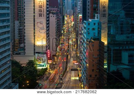 Hong Kong, China - Jun 4, 2017: Cars travellign along the Nathan Road in Hong Kong at night. The Nathan Road is lined with many shops and restaurants and is a popular tourists attraction in Hong Kong.