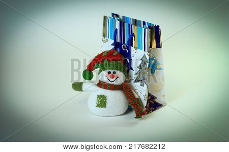 snowman and shopping bag.isolated on white background .photo with copy space