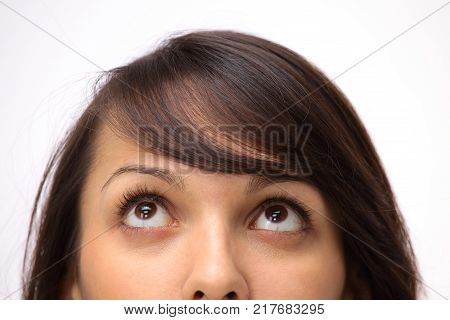 closeup. young business woman looking up.isolated on white.