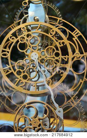 Abstract image with mechanical clocks of unusual and strange design. Metal composition, like a clockwork