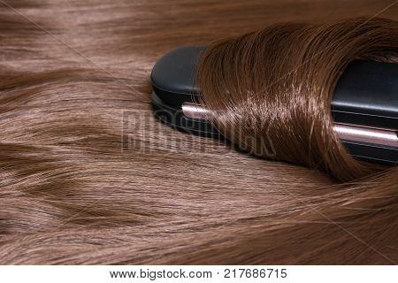 Hair straightener. Brilliant smooth beautiful hair and hair curler. poster