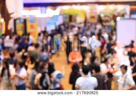 Abstract Blurred Image Of People Walking In Shopping Centre Or Exhibition Hall Event Background.
