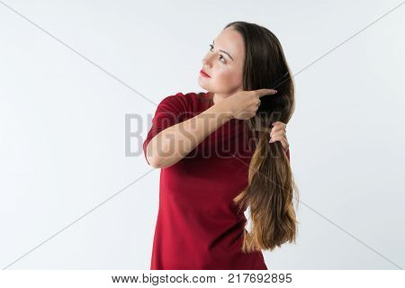 beautiful stylish young girl combs her hair with a comb. white background