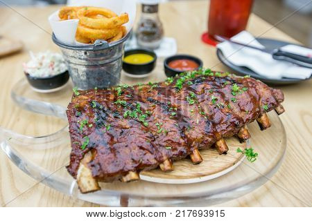 Slow roasted BBQ pork ribs on wooden table