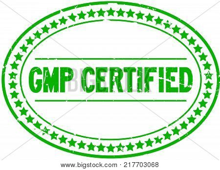 Grunge green GMP certified oval rubber seal stamp on white background