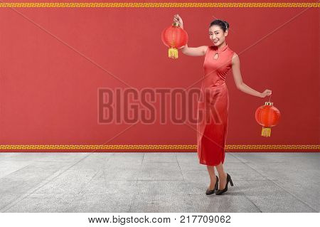 Portrait Of Chinese Woman In A Traditional Dress Holding Chinese Lantern