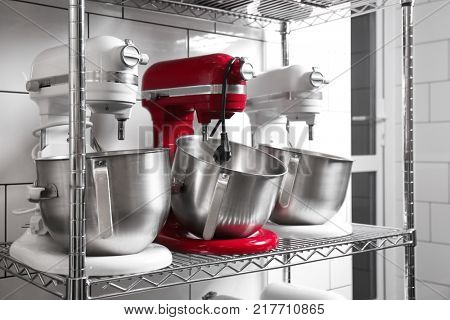 Shelving with kitchen appliances in bakery