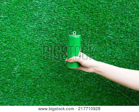 Hand hold show Recyclable Symbol plastic bottle a White background and paper cutter