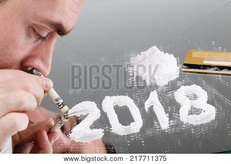 Conceptual Photo Of Man Uses Cocaine In The Form Of The Number Of 2018.