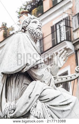 King David Statue , detail of the base of the Column monument to the Immaculate Conception, by Adamo Tadolini in 1856 located in Piazza di Spagna in Rome. italy