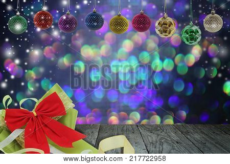 Christmas background with christmas ball and snow on a balconyabstract circular bokeh background