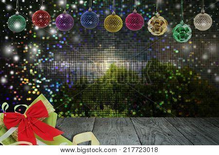 Christmas background with christmas ball and snow on a balconyabstract circular bokeh and pine background