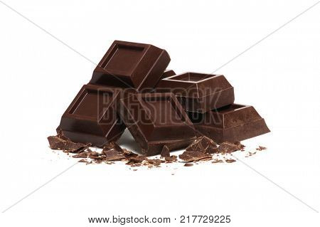 broken bar of dark chocolate isolated on white