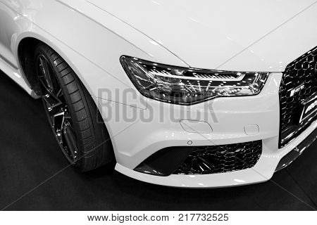 Sankt-Petersburg Russia July 21 2017: Front view of a modern luxury sport car Audi RS 6 Avant Quattro 2017. Car exterior details. Black and white. Photo Taken on Royal Auto Show July 21