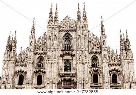 Famous Milan Cathedral is the fifth largest cathedral in the world. Detail of the front isolated on white Milan, Italy