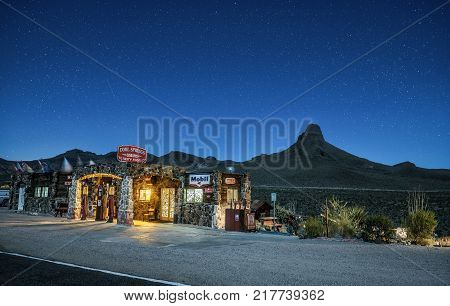 COOL SPRINGS, ARIZONA, USA - MAY 19, 2016 : Night sky with many stars above rebuilt Cool Springs station in the Mojave desert on historic route 66 in Arizona