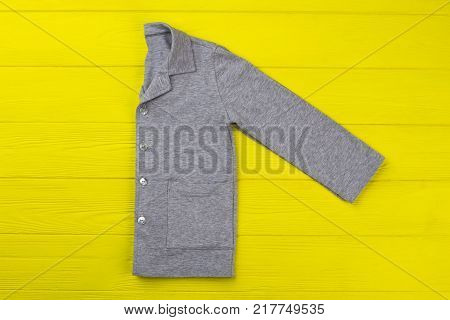 Boys shirt with pockets on yellow background. Gray melange cotton. Sleepwear for comfy night rest and lounge.