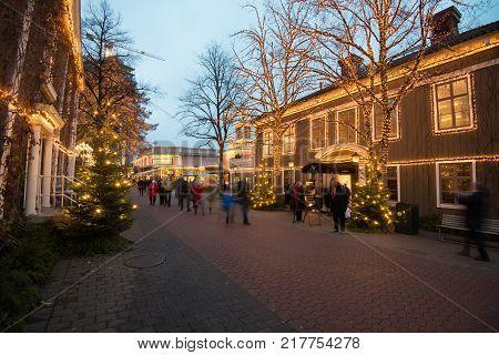 GOTHENBURG - NOVEMBER 16, 2013: People stroll at Liseberg on November 16, 2013 in Gothenburg. The Christmas market at Liseberg is an annual tradition.
