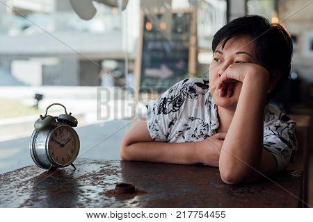 Asian Women Dismal Phone Call In A Coffee Shop