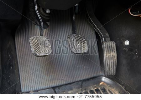 Pedals of a car driving manual gearbox