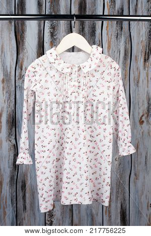 Peasant nightie for teenage girl. Lightweight cotton with floral pattern, ruffled cuffs and collar. Looking good while sleeping or lounging.
