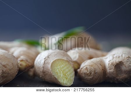 Fresh ginger root on dark background. Close up, Selective focus