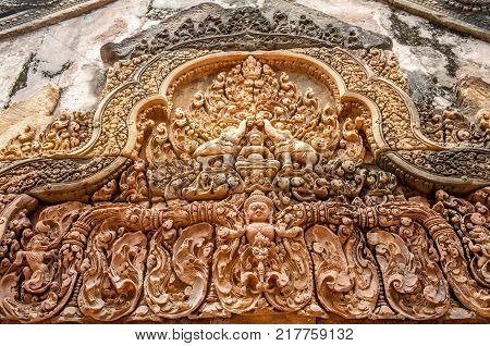 Architectural detail at Banteay Srei, a 10th century Hindu temple dedicated to Shiva. The temple was forgotten for centuries and rediscovered 1814 in the jungle of the Angkor area of Cambodia.