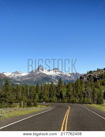 Pilot Peak is a prominent mountain peak in the Absaroka Range in Park County, Wyoming. The peak is visible from US Route 212, the Beartooth Highway just east of the Northeast Entrance to Yellowstone.