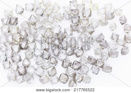 Collection of faceted natural transparent diamonds in macro on a white background