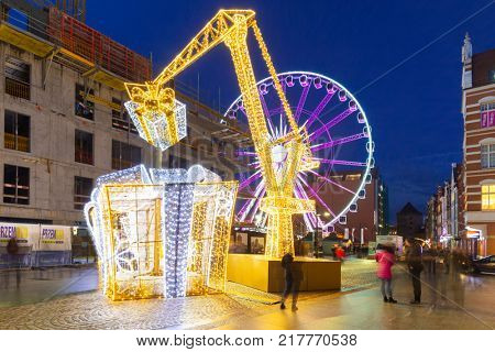GDANSK, POLAND - DECEMBER 8, 2017: Christmas decorations and ferris wheel in old town of Gdansk, Poland. Gdansk is the historical capital of Polish Pomerania with gothic architecture.