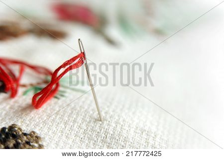 Needle In Canvas With Red Thread For Embroidery. Embroidery Macro Close Up. View From Above. Free Co
