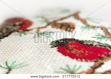 Cross-stitch Embroidery. Cones On A Fir-tree Embroidery Macro Close Up. View From Above.